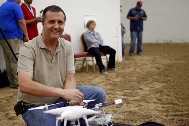 Gary Buzel, of AviSight Aerial and Drone Services, preps a DJI Phantom drone for flight during a during a drone pilot training course by AviSight at the South Point Casino on Thursday,  Aug. 25, 2 ...