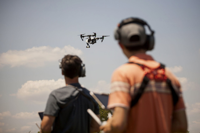 Mike Ferguson, chief pilot at AeroCine (left) and Jeff Brink, director of Flight-Ops and co-founder of AeroCine, operate a DJI Inspire drone at Calvert Vaux Park in the borough of Brooklyn, New Yo ...