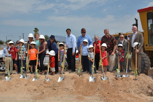 Clark County School District superintendent Pat Skorkowsky and students from Lincoln Elementary School, 3010 Berg Street, pose for a photo during the groundbreaking ceremony at the site of the rep ...