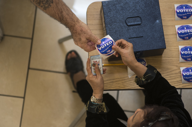 A voter recieves his I Voted sticker during early voting at Meadows Mall in Las Vegas on Saturday, March 21, 2015. (Martin S. Fuentes/Las Vegas Review-Journal)