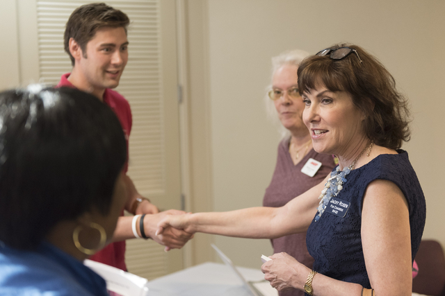 Jacky Rosen, Democratic candidate for the 3rd Congressional District, right, speaks with senior citizens and AARP staff and volunteers during an open house to discuss protecting Social Security at ...