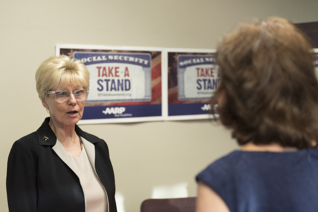 Selma Sikes, left, speaks with Jacky Rosen, Democratic candidate for the 3rd Congressional District, during an open house to discuss protecting Social Security at the AARP Take A Stand campaign of ...