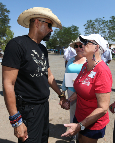 Milwaukee County Sheriff David A. Clarke, Jr., talks with Gold Star mom Sally Wiley at the second annual Basque Fry in Gardnerville, Nev., on Saturday, Aug. 20, 2016. Clarke was a featured speaker ...