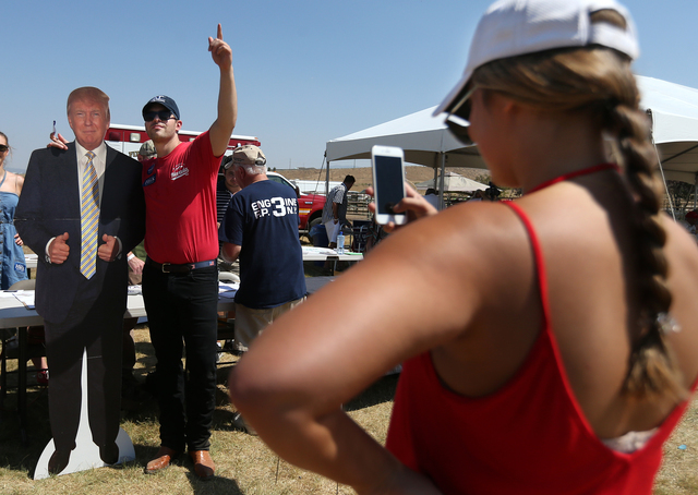 Mackenzie Taylor take a photo of Brian Kehoe during the second annual Basque Fry in Gardnerville, Nev., on Saturday, Aug. 20, 2016. The Republican rally and Basque-style barbeque drew more than 1, ...