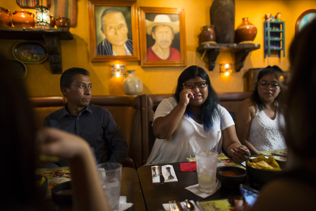 Eighteen-year-old Noemi Guigui, center, talks about her her undocumented parents who have lived in the U.S. for more than 20 years, during a lunch with U.S. Senate Democratic candidate Catherine C ...