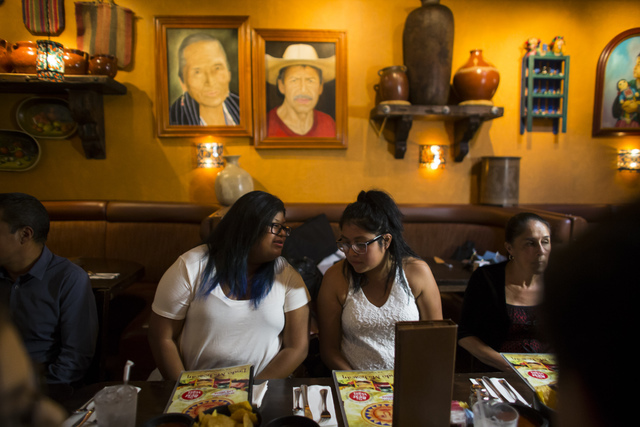 Eighteen-year-old Noemi Guigui, left, talks with sister Brenda, 22, during a lunch with U.S. Senate Democratic candidate Catherine Cortez Masto, not pictured, at Lindo Michoacan in Las Vegas on We ...