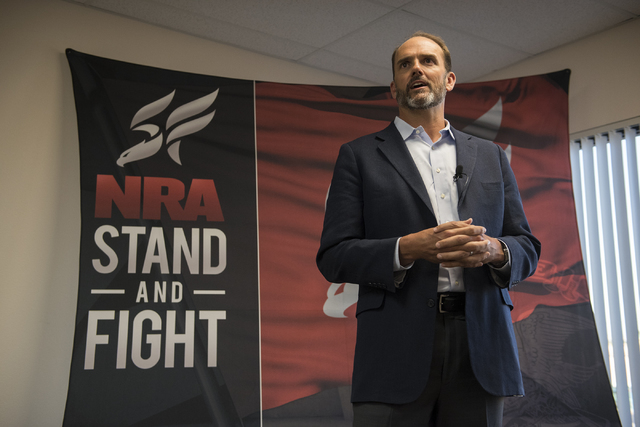 NRA Nevadans for Freedom campaign manager Robert Uithoven speaks to volunteers and attendees during the grand opening for a campaign office at 6375 S. Pecos Road in Las Vegas, Tuesday, Aug. 9, 201 ...