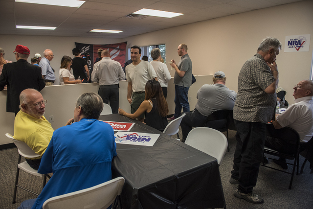 Volunteers and attendees are seen at the grand opening for a National Rifle Association campaign office at 6375 S. Pecos Road in Las Vegas, Tuesday, Aug. 9, 2016. Martin S. Fuentes/Las Vegas Revie ...