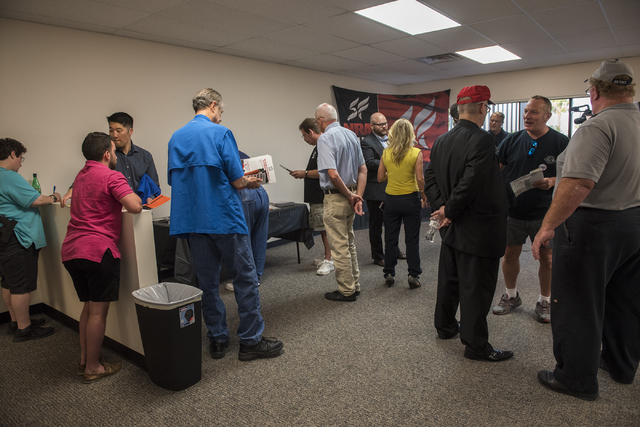 Volunteers and attendees are seen at the grand opening for a National Rifle Association campaign office at 6375 S. Pecos Road in Las Vegas Tuesday, Aug. 9, 2016. Martin S. Fuentes/Las Vegas Review ...
