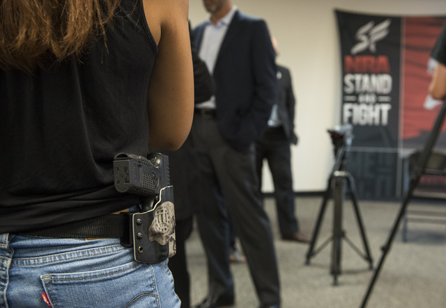 An attendee with an open carry firearm is shown during the grand opening for an NRA Nevadans for Freedom campaign office at 6375 S. Pecos Road in Las Vegas, Tuesday, Aug. 9, 2016. Martin S. Fuente ...