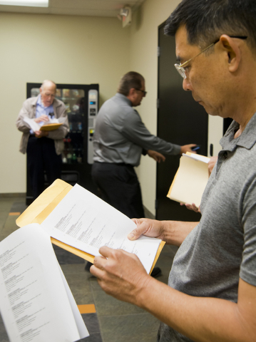 George Lee looks over the agenda before a meeting of the Nevada State Contractors Board at their offices in Henderson on Thursday, Aug. 4, 2016. Daniel Clark/Las Vegas Review-Journal Follow @DanJC ...