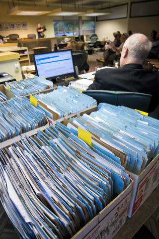 Over a hundred files with cases relating to Summerlin Energy's bankruptcy sit on a table during a meeting of the Nevada State Contractors Board at their offices in Henderson on Thursday, Aug. 4, 2 ...