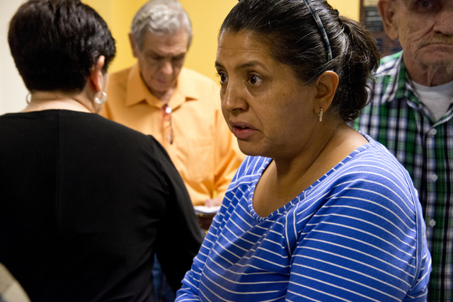 Carmen Morales speaks with other homeowners affected by Summerlin Energy's bankruptcy after a meeting of the Nevada State Contractors Board at their offices in Henderson on Thursday, Aug. 4, 2016. ...