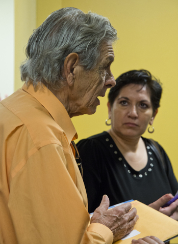 Miguel Velazquez speaks with other homeowners affected by Summerlin Energy's bankruptcy after a meeting of the Nevada State Contractors Board at their offices in Henderson on Thursday, Aug. 4, 201 ...