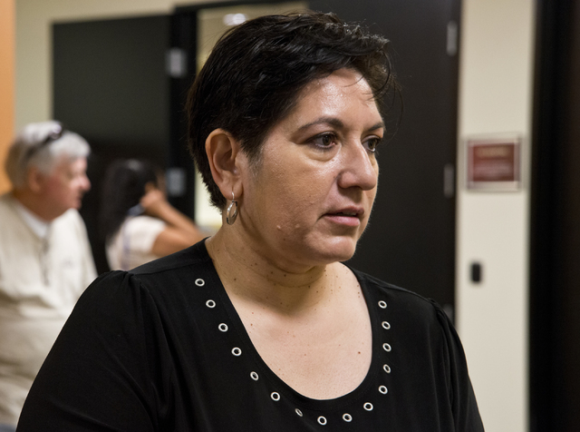 Maria Escamilla speaks with other homeowners affected by Summerlin Energy's bankruptcy after a meeting of the Nevada State Contractors Board at their offices in Henderson on Thursday, Aug. 4, 2016 ...