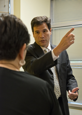 Director of Investigations Paul Rozario speaks with homeowners affected by Summerlin Energy's bankruptcy after a meeting of the Nevada State Contractors Board at their offices in Henderson on Thur ...