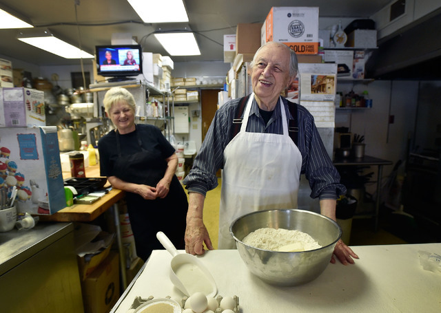 Ernie Feld, right, and his wife, Marika, smile as he prepares dough for a batch of challahs Wednesday, June 8, 2016, in Incline Village, Nev. The 91-year-old Feld continues to bake at his pastry s ...