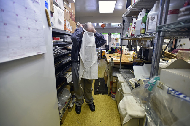 Ernie Feld slips on his apron for another day of baking at his pastry shop Wednesday, June 8, 2016, in Incline Village, Nev. The 91-year-old Feld continues to bake at his pastry shop near the shor ...