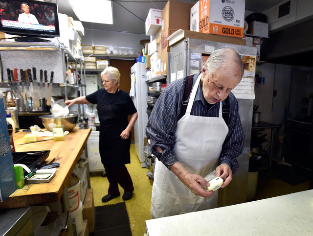 Ernie Feld, right, with his wife Marika nearby, prepares dough for a batch of challahs Wednesday, June 8, 2016, in Incline Village, Nev. The 91-year-old Feld continues to bake at his pastry shop n ...