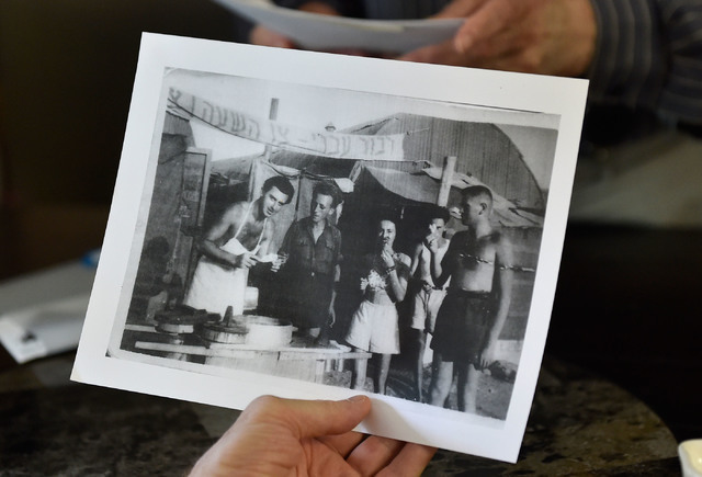 A 1948 photograph, showing a young Ernie Feld,left, serving up ice cream, is displayed at Ernie's International Pastries Wednesday, June 8, 2016, in Incline Village, Nev. The 91-year-old Feld cont ...