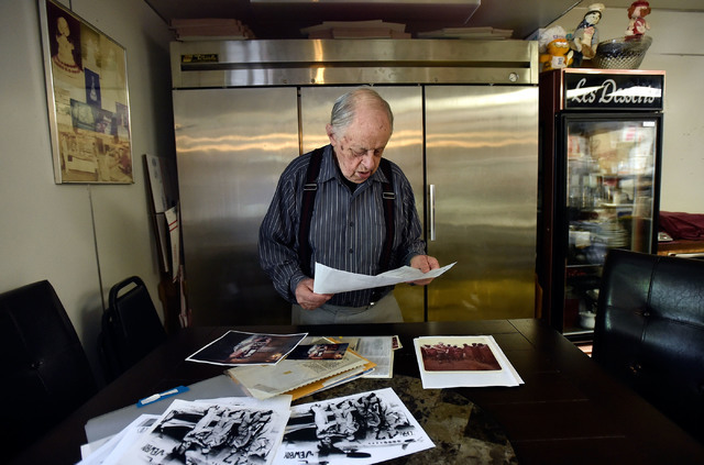 Ernie Feld looks over photographs at his pastry shop Wednesday, June 8, 2016, in Incline Village, Nev. The 91-year-old Feld continues to make his popular poppy-seed strudels at his bakery near the ...