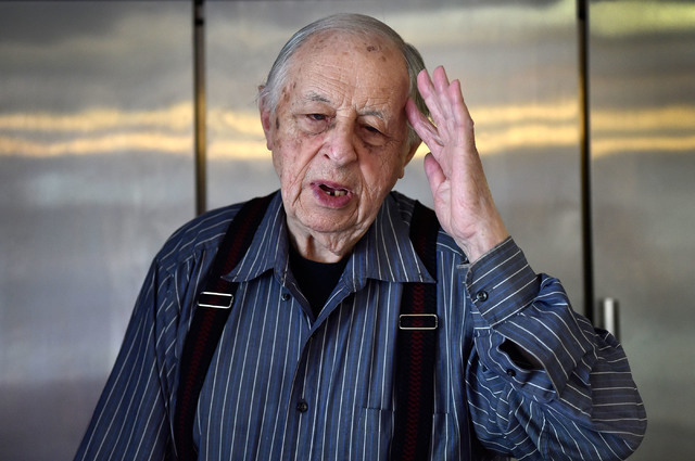 Ernie Feld gestures as he recalls his time as a baker during World War II at his pastry shop Wednesday, June 8, 2016, in Incline Village, Nev. The 91-year-old Feld continues to make his popular po ...
