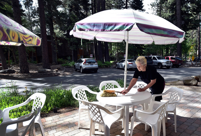 Marika Feld dusts off patio tables as she readies for customers at Ernie's International Pastries Wednesday, June 8, 2016, in Incline Village, Nev. Feld's husband, Ernie, started his baking career ...