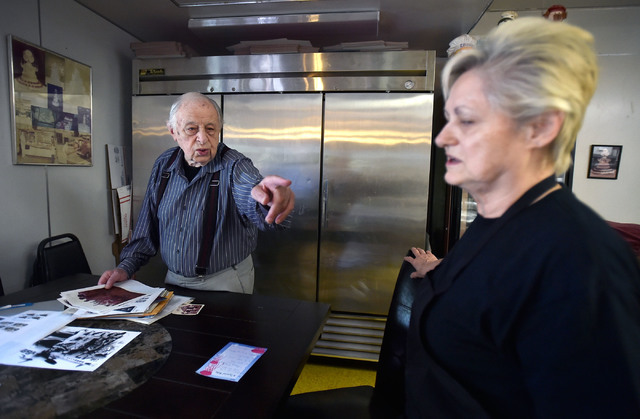 Ernie Feld, left, gives directions to his wife, Marika, at his Incline Village, Nev. bakery Wednesday, June 8, 2016. The 91-year-old Feld, who says his life was saved by his ability to bake, conti ...