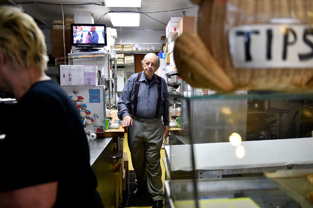 Ernie Feld, right, makes his way up front to meet his wife, Marika, inside his pastry shop Wednesday, June 8, 2016, in Incline Village, Nev. The 91-year-old Feld continues to bake at his pastry sh ...