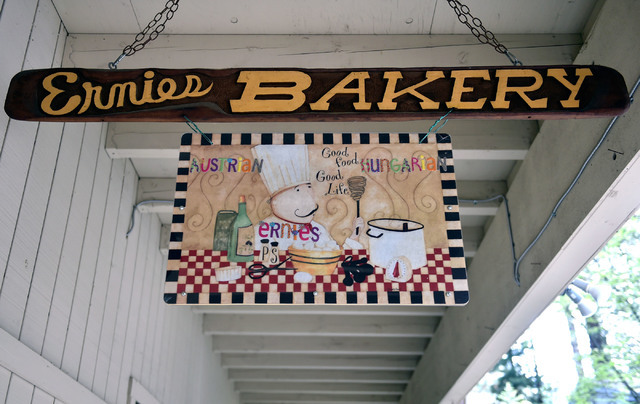 A hanging sign is displayed in front of Ernie's International Pastries on Wednesday, June 8, 2016, in Incline Village, Nev. The 91-year-old Feld continues to bake at his pastry shop near the shore ...