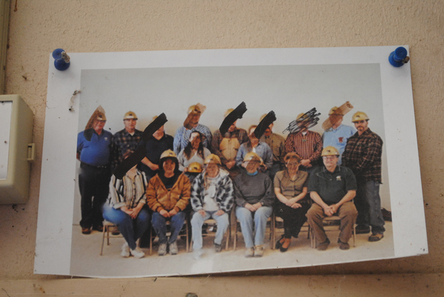 A photo remains on the wall showing former employees of USG, the gypsum-mining company that owned the town of Empire. (Jenny Kane /The Reno Gazette-Journal via AP)
