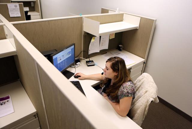 Amanda Schlichtenmyer looks through Nevada Health Link training materials in between taking calls at Siler State Health Insurance Exchange call center Tuesday, Sept. 24, 2013, in Henderson. Staff  ...