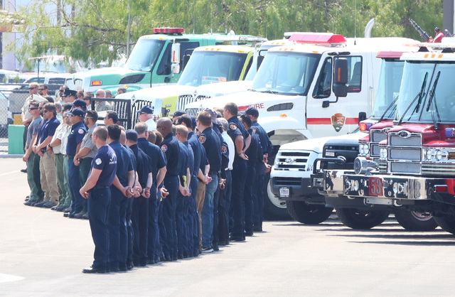 Firefighters from Las Vegas, Nye County, the U.S. Forest Service and Las Vegas police officers line up at the North Las Vegas Airport as the casket containing fallen U.S. Forest Service firefighte ...