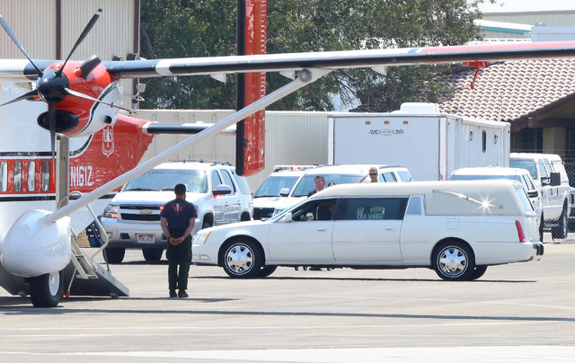 The hearse carrying the casket of fallen U.S. Forest Service firefighter Justin Beebe arrives at the North Las Vegas Airport on Wednesday, Aug. 17, 2016. Bizuayehu Tesfaye/Las Vegas Review-Journal ...