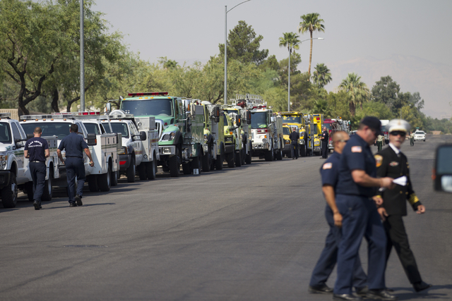 Fire trucks are lined up for the funeral procession for fallen U.S. Forest Service firefighter Justin Beebe at a Davis Funeral Home on Wednesday, Aug. 17, 2016, in Las Vegas. (Erik Verduzco/Las Ve ...