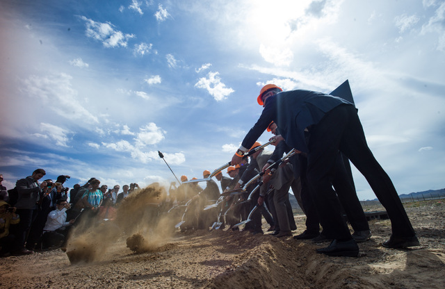 Government and Faraday Future officials shovel dirt during the groundbreaking for the company's planned 900-acre manufacturing site in North Las Vegas on Wednesday, April 13, 2016. (Chase Stevens/ ...