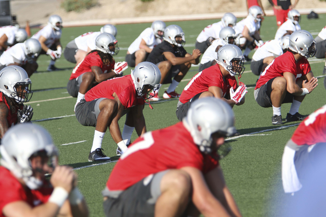 UNLV Rebels football players are seen during team practice at the Bill 'Wildcat' Morris Rebel Park field on Friday, Aug. 5, 2016. (Richard Brian/Las Vegas Review-Journal) Follow @vegasphotograph