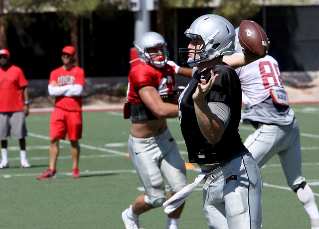 UNLV quarterback Johnny Stanton throws a pass during a public scrimmage at Rebel Park on the UNLV campus Saturday, Aug. 13, 2026. (Richard Brian/Las Vegas Review-Journal) Follow @vegasphotograph