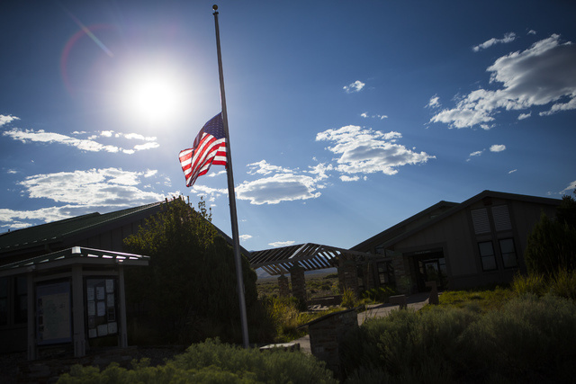 A flag hangs at half-mast at the Great Basin National Park Visitor Center in Baker, Nev., on Sunday, Aug. 14, 2016. Firefighter Justin Beebe of Bellows Falls, Vt., died Saturday afternoon while on ...