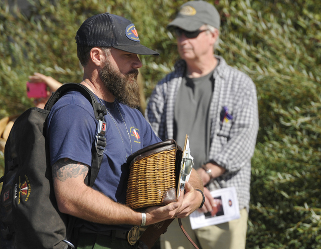 People attend a memorial service for fallen U.S. Forest Service firefighter Justin Beebe, Saturday, Aug. 20, 2016, in Missoula, Mont. (Tommy Martino/The Missoulian via AP)