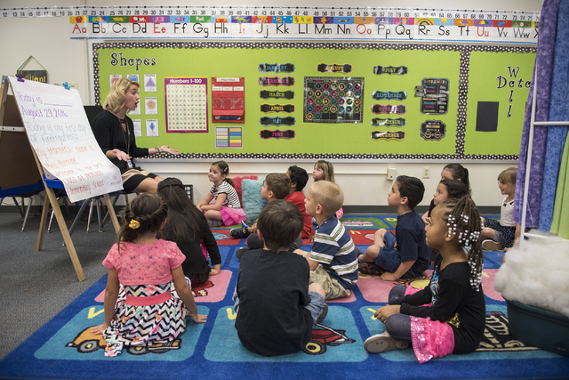 Kindergarten teacher Jordan Pirrone, left, greets kindergarten students on the first day of school at James B. McMillan Elementary School in Las Vegas on Monday, Aug. 29, 2016. Martin S. Fuentes/L ...