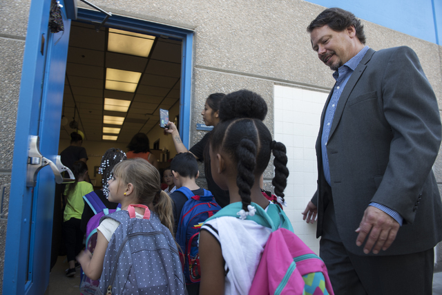 Clark County School District Superintendent Superintendent Pat Skorkowsky, right, walks kindergarten students into their classroom on the first day of school at James B. McMillan Elementary School ...