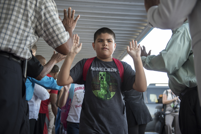 A student is greeted by over 100 male role models on the first day of school at Matt Kelly Elementary School in Las Vegas on Monday, Aug. 29, 2016. Nevada Youth Network recruited over 100 male rol ...