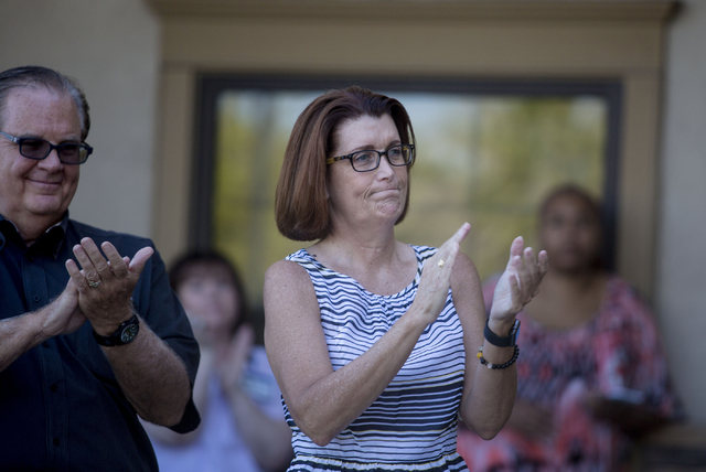 Angela Quinn, CEO of FirstMed Health and Wellness Center, claps while U.S. Sen. Harry Reid of Nevada speaks during the opening of the second FirstMed Health and Wellness Center location Tuesday, A ...
