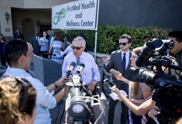 U.S. Sen. Harry Reid of Nevada answers questions during the opening of the second FirstMed Health and Wellness Center location Tuesday, Aug. 16, 2016, in Las Vegas. Elizabeth Page Brumley/Las Vega ...
