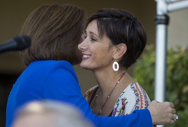 Former Nevada Attorney General Catherine Cortez Masto hugs the founder of the Embracing Project Esther Brown  during the opening of the second FirstMed Health and Wellness Center location Tuesday, ...