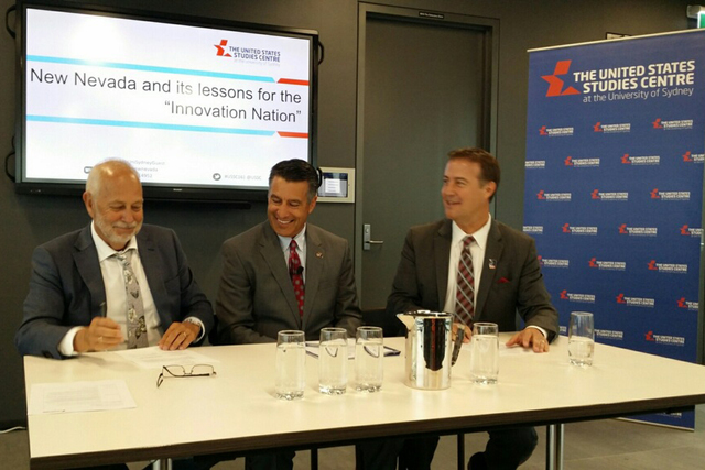 Gov. Brian Sandoval, center, attending a signing between Alex Blaszczynski of the University of Sydney and Dr. Bo Bernhard, executive director of the International Gaming Institute at UNLV, to for ...
