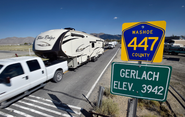 Trucks with trailers travel along highway 447 through Gerlach, Nev. in route to the Black Rock Desert, Tuesday, Aug. 23, 2016. Seventy thousand people are expected to travel though the small and q ...