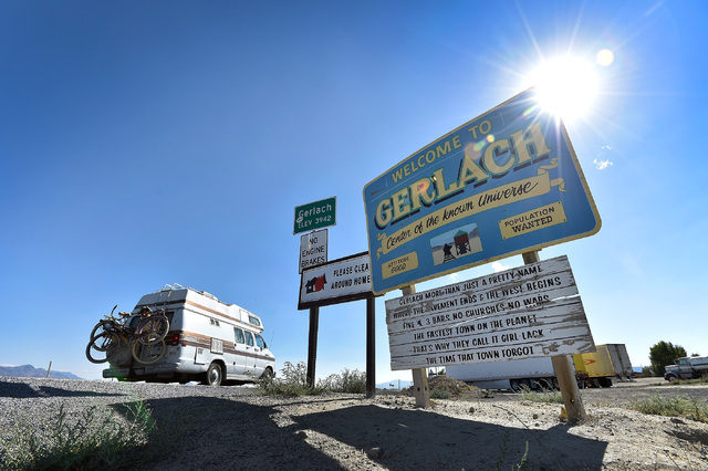 A camper van travels along highway 447 as it enters Gerlach, Nev. in route to the Black Rock Desert, Tuesday, Aug. 23, 2016. Seventy thousand people are expected to travel though this small and qu ...