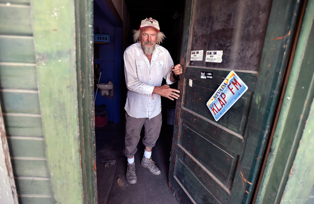 Michael Hopkins, aka Flash, opens the door to his radio station, KLAP, in Gerlach, Nev., Tuesday, Aug. 23, 2016. Hopkins, who has been part of the Burning Man Festival for several decades makes th ...